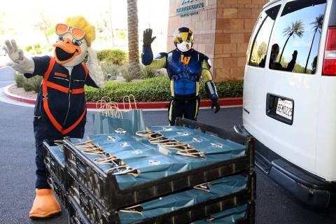 Las Vegas Aviators mascots Spruce and Aviator donate baseball swag at Summerlin Hospital Medica ...