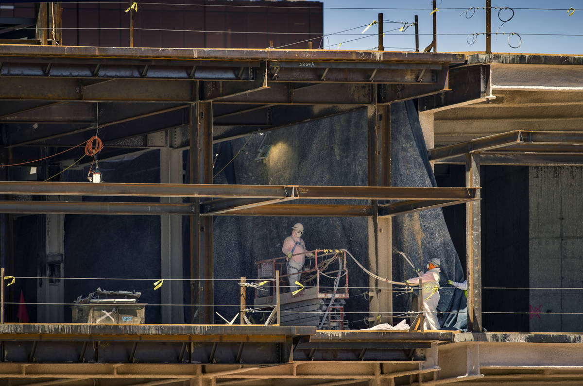 Crews work as construction continues on Resorts World on Tuesday, April 14, 2020 in Las Vegas. ...