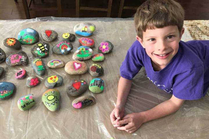 Las Vegas second-grader Braden Hahn paints rocks for neighbors. (Kimberly Hahn)