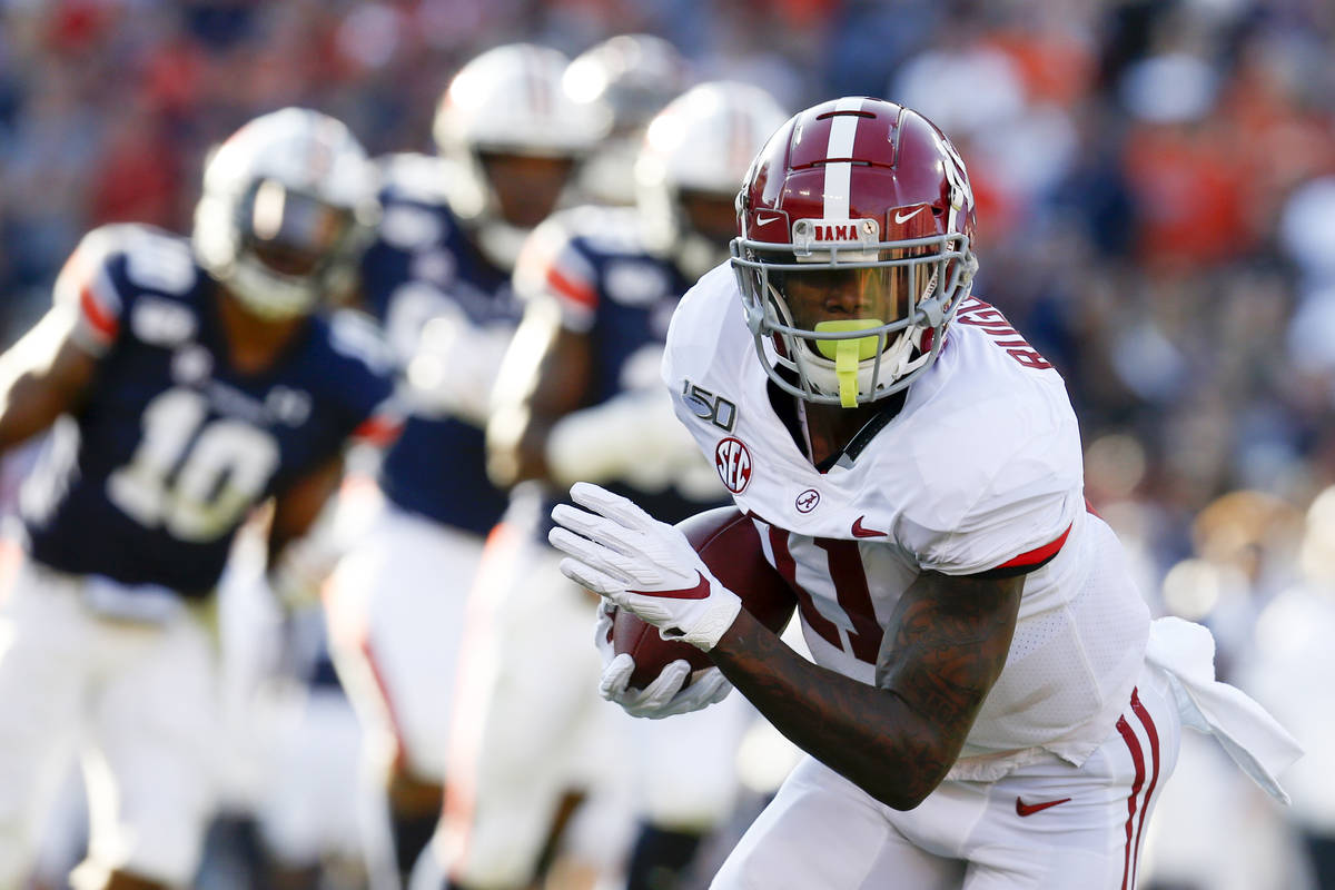 Alabama wide receiver Henry Ruggs III (11) catches a pass against Auburn during the first half ...