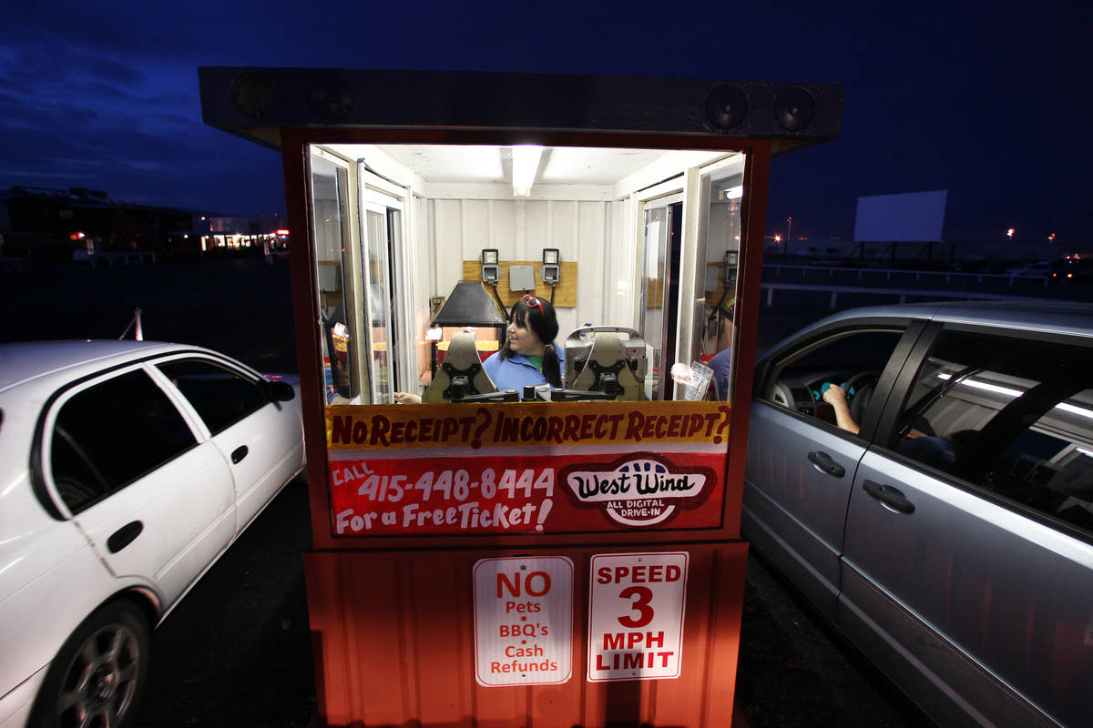 Courtney Garcia takes admission at the West Wind Drive-In Tuesday, May 12, 2015. (Review-Journa ...