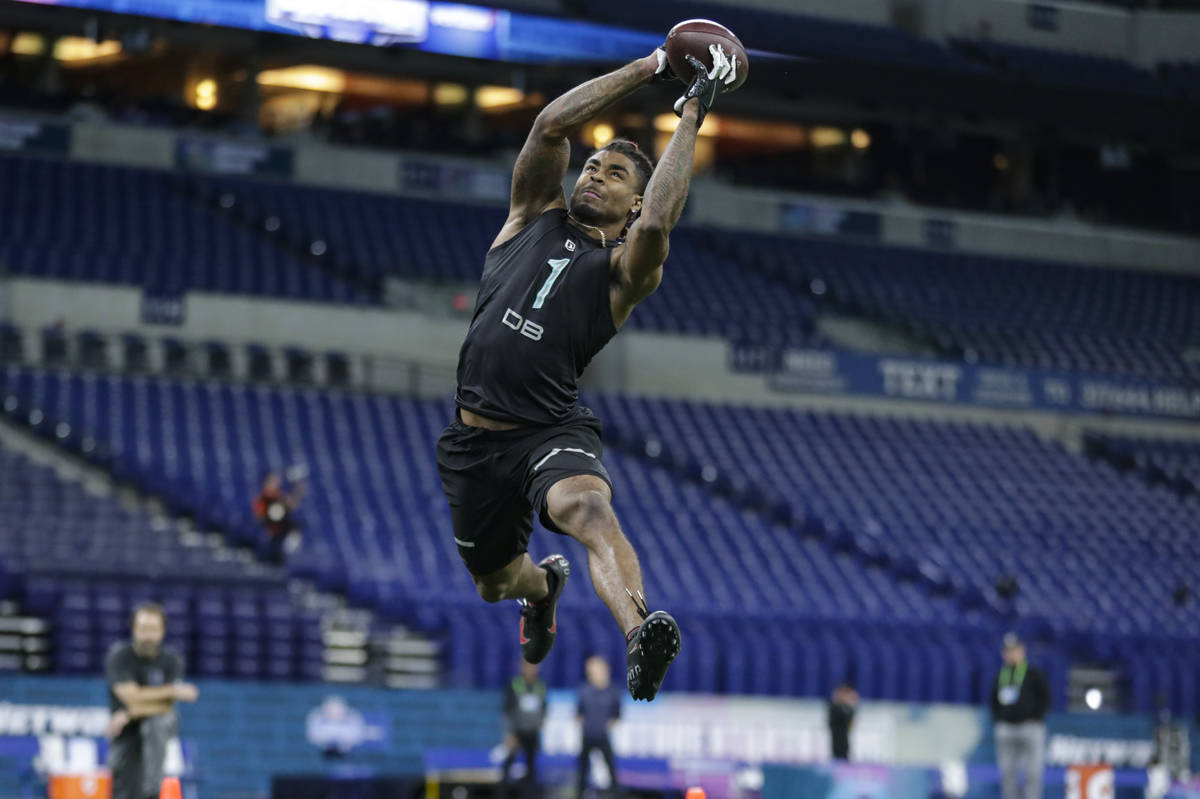 Ohio State defensive back Damon Arnette runs a drill at the NFL football scouting combine in In ...