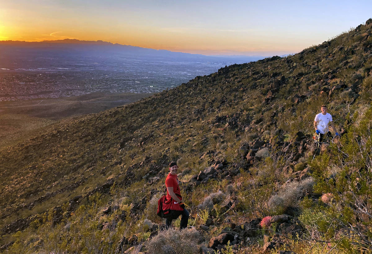 Michael, left, and Mason Koch atop of Black Mountain readjusting the heart within the Nevada li ...
