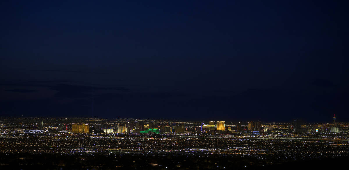 The view of Las Vegas from the base of the Black Mountain Trail as night falls on Wednesday, Ap ...