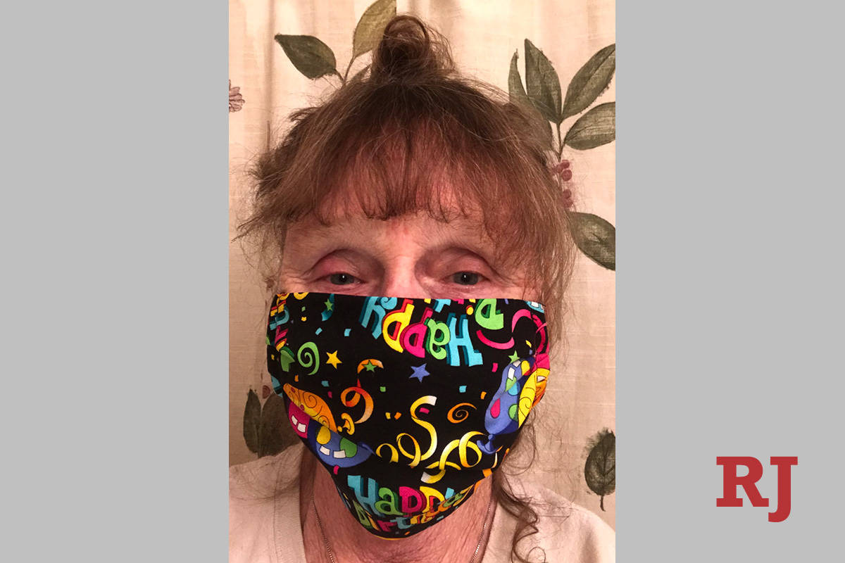 13668056_web1_mask-lady.jpg