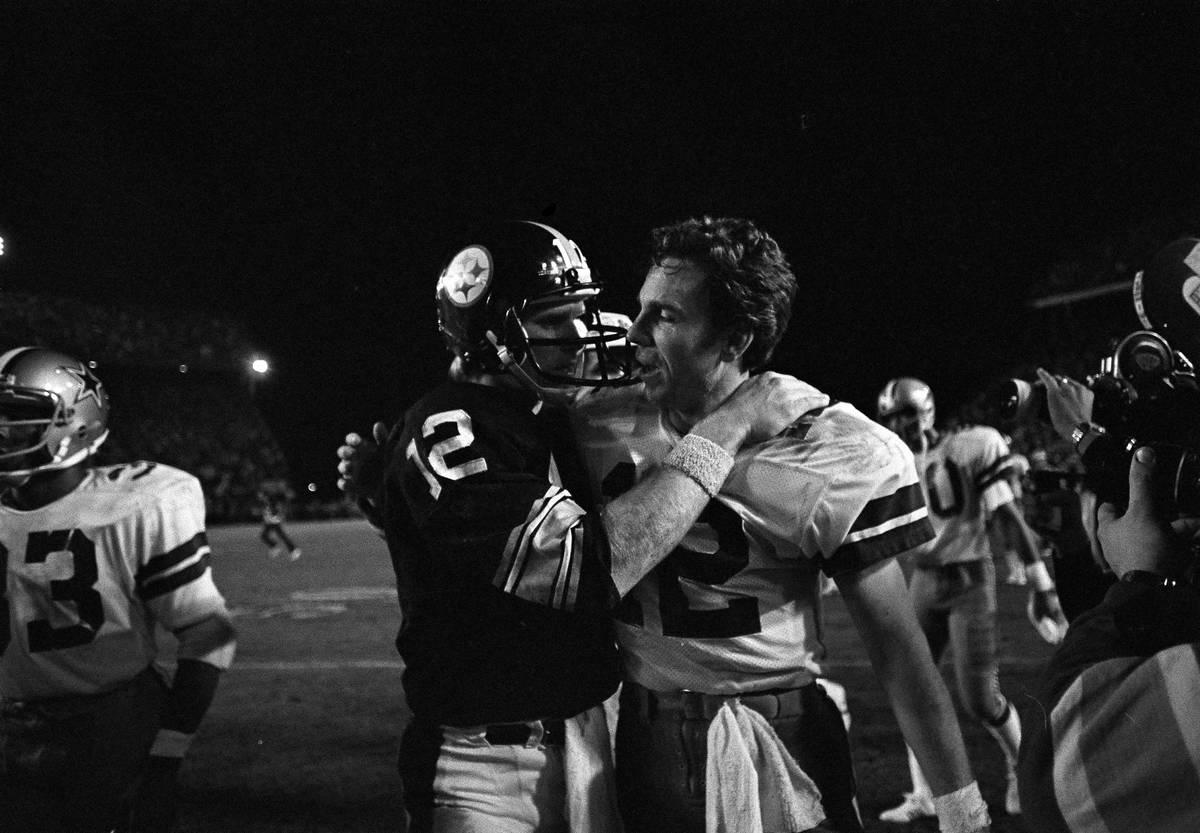 Dallas Cowboys quarterback Roger Staubach, right, and Pittsburgh Steelers quarterback Terry Bra ...