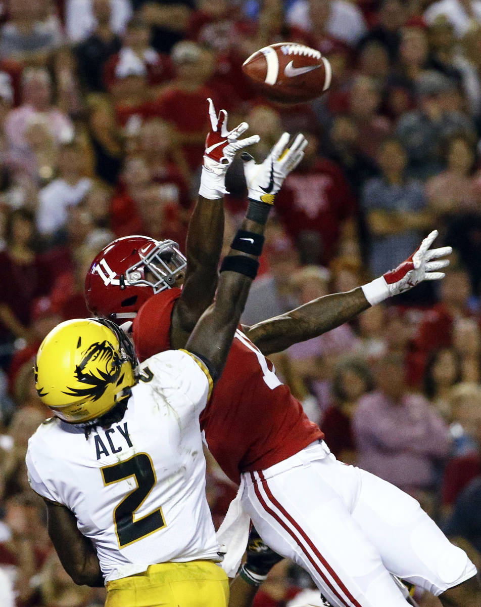 Missouri defensive back DeMarkus Acy (2) breaks up a pass intended for Alabama wide receiver He ...