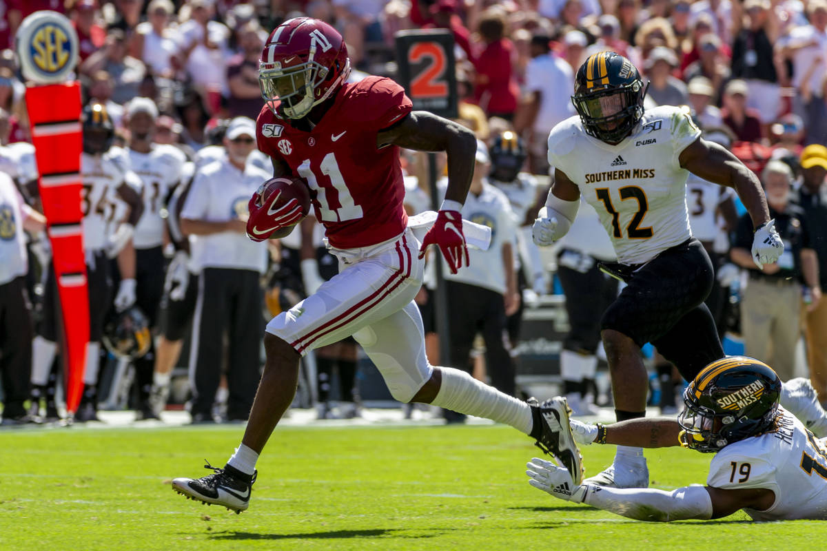 FILE - In this Sept. 21, 2019, file photo, Alabama wide receiver Henry Ruggs (11) runs in for a ...