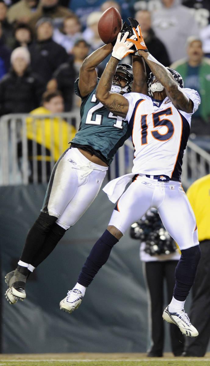 Philadelphia Eagles' Sheldon Brown, left, breaks up a pass intended for Denver Broncos' Brandon ...