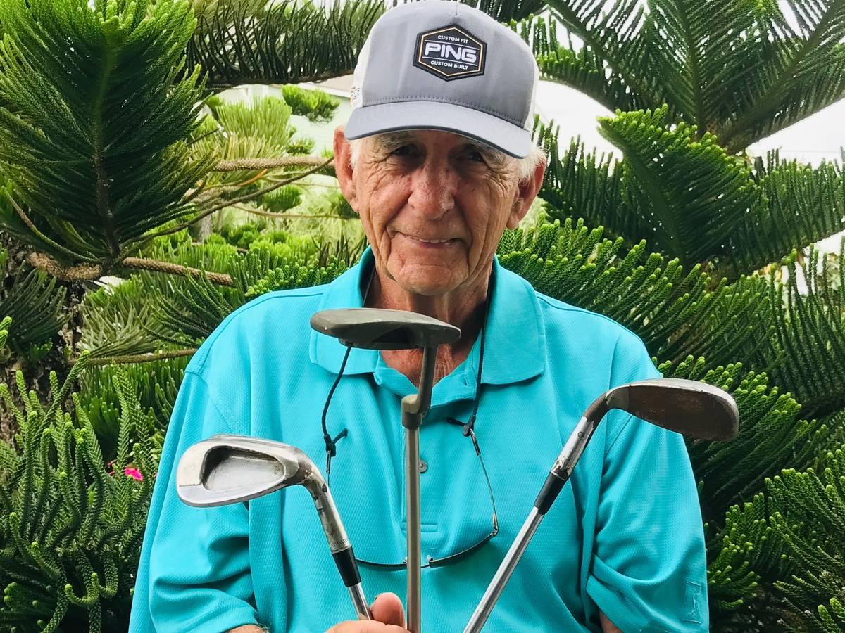 Babe Hiskey, 50 years later, shows off some of the historic PING clubs used to win the 1970 Sah ...