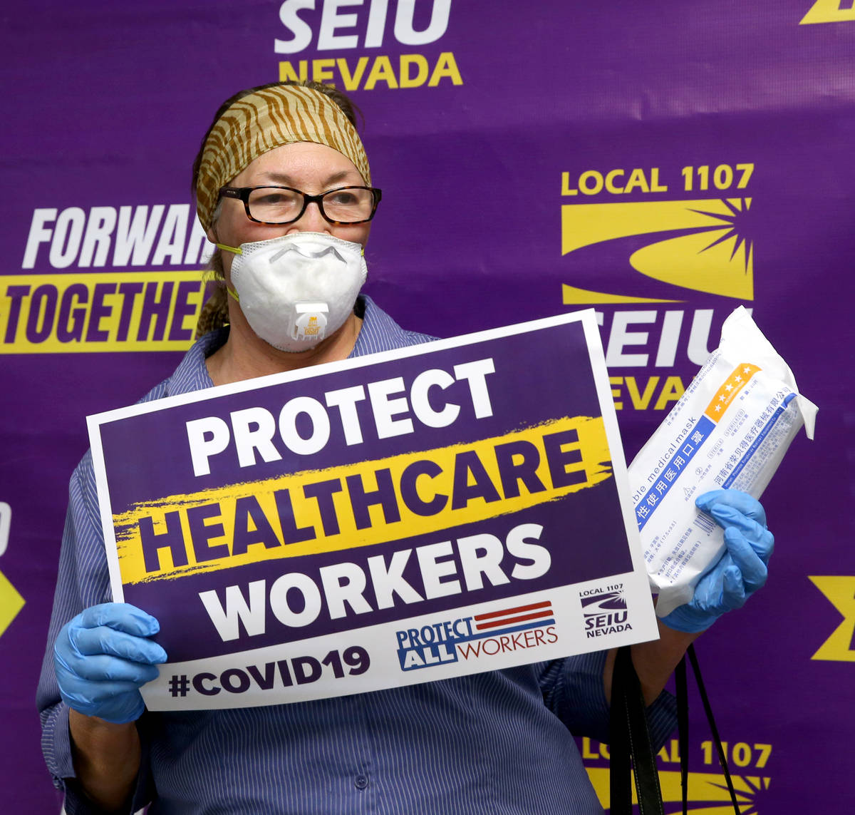Personal health care worker Barbara Polinsky poses after receiving medical masks at SEIU Local ...