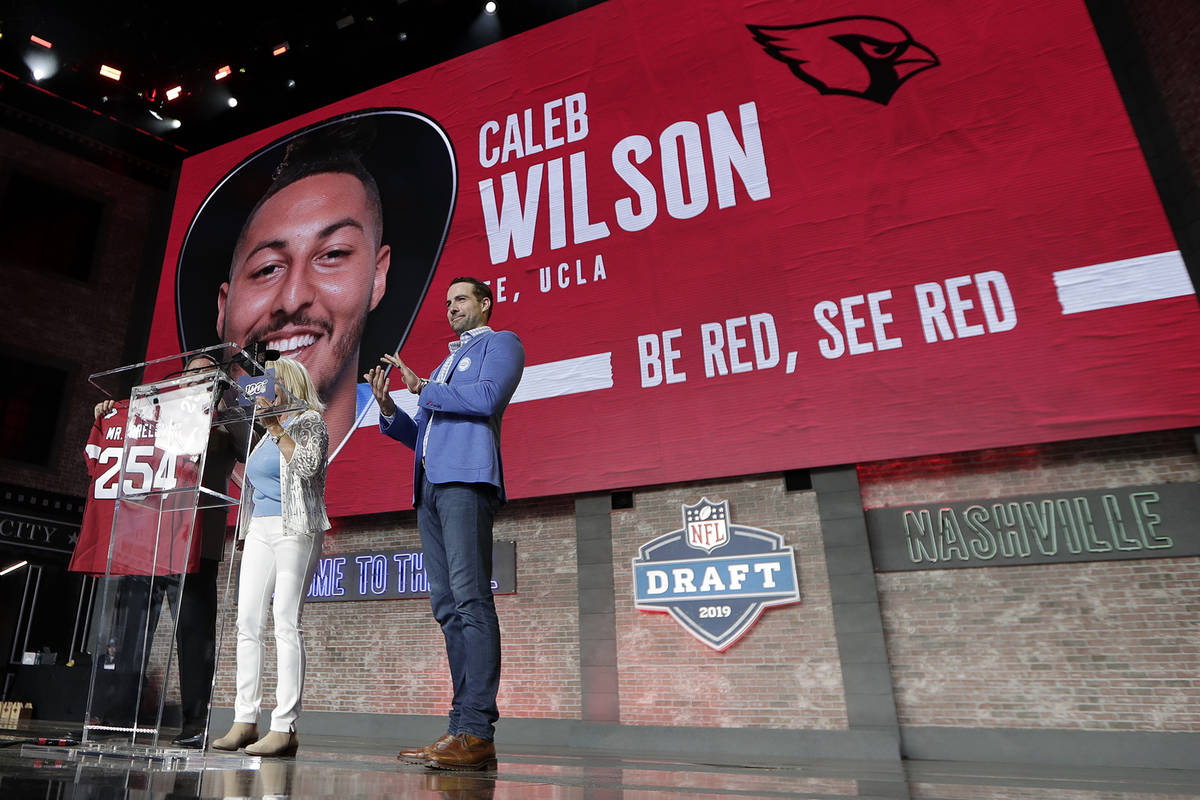 Tennessee Titans kicker Ryan Succop, right, announces the final pick of the NFL football draft ...