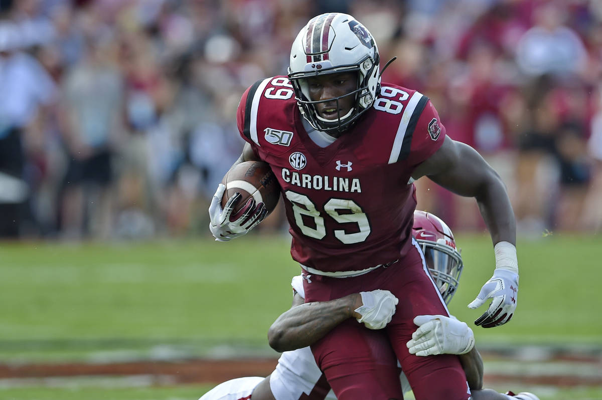 South Carolina's Bryan Edwards (89) rushes while tackled by Alabama's Xavier McKinney during th ...