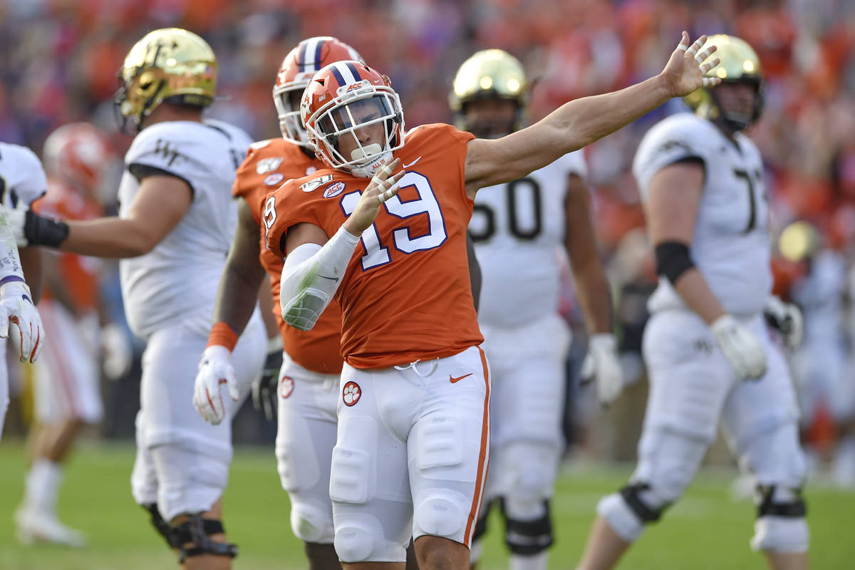 FILE - In this Nov. 16, 2019, file photo, Clemson's Tanner Muse reacts after sacking Wake Fores ...