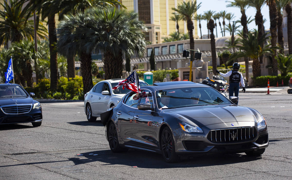 """Wayne Allyn Root, sitting in the front passenger seat of a Maserati, leads a """"caravan&quot ..."""