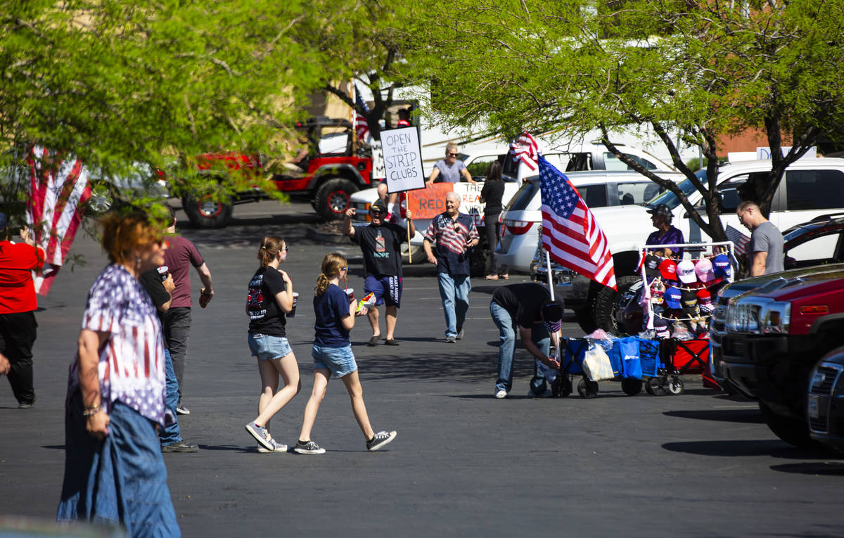 """People gather at the Las Vegas South Premium Outlets before participating in a """"caravan&qu ..."""