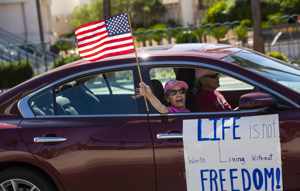 """People participate in a """"caravan"""" protest led by Wayne Allyn Root, not pictured, alon ..."""