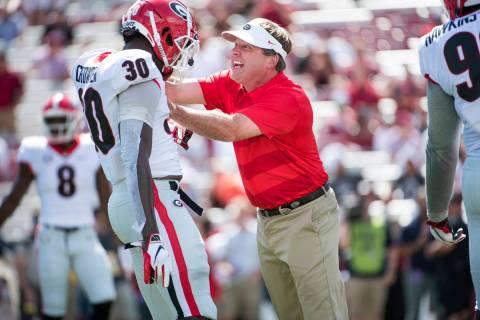 Georgia head coach Kirby Smart yells at Tae Crowder (30) before an NCAA college football game a ...