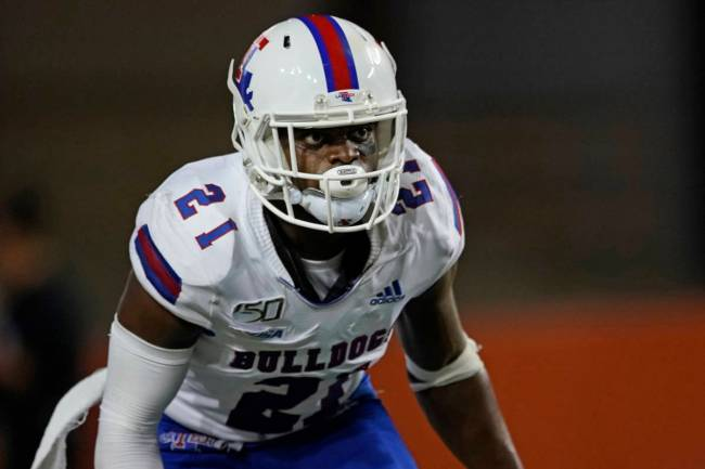 Louisiana Tech's Amik Robertson (21) defends against Texas during the second half of an NCAA co ...