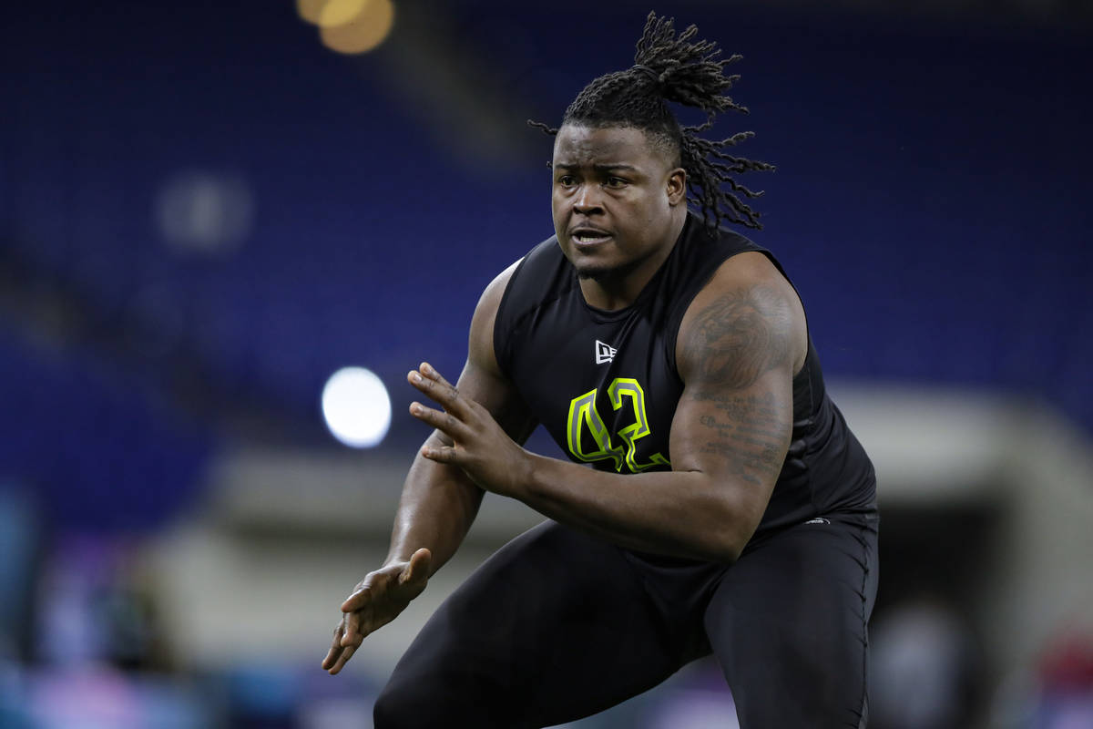 Clemson offensive lineman John Simpson runs a drill at the NFL football scouting combine in Ind ...