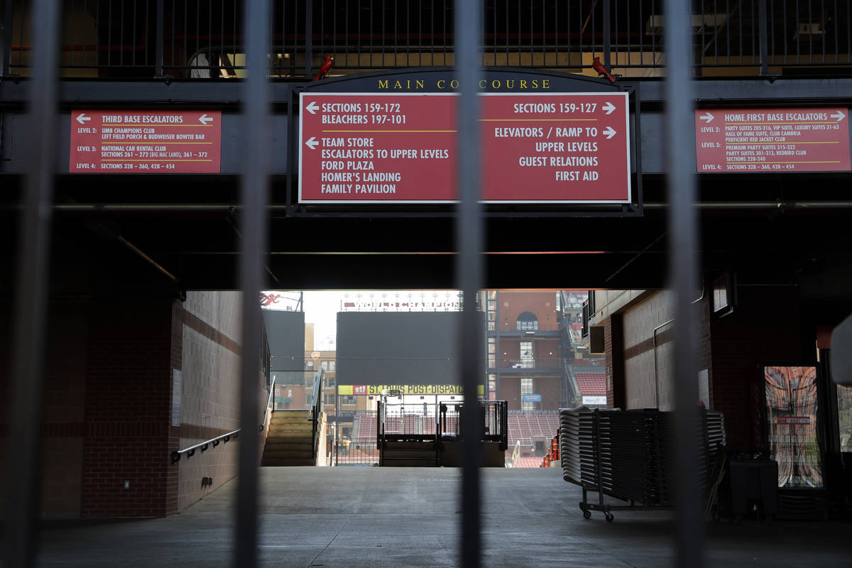 A concourse inside Busch Stadium, home of the St. Louis Cardinals baseball team, is seen throug ...