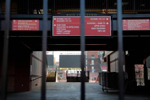 A concourse inside Busch Stadium, home of the St. Louis Cardinals baseball team, is seen throug ...