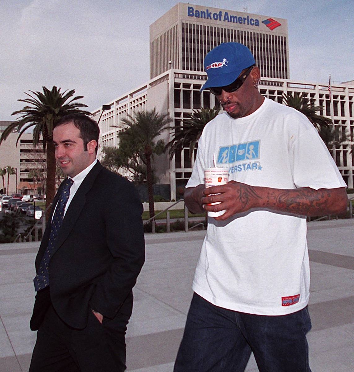 Dennis Rodman walks into federal court in Las Vegas on Dec. 11, 2000, with his attorney for a d ...