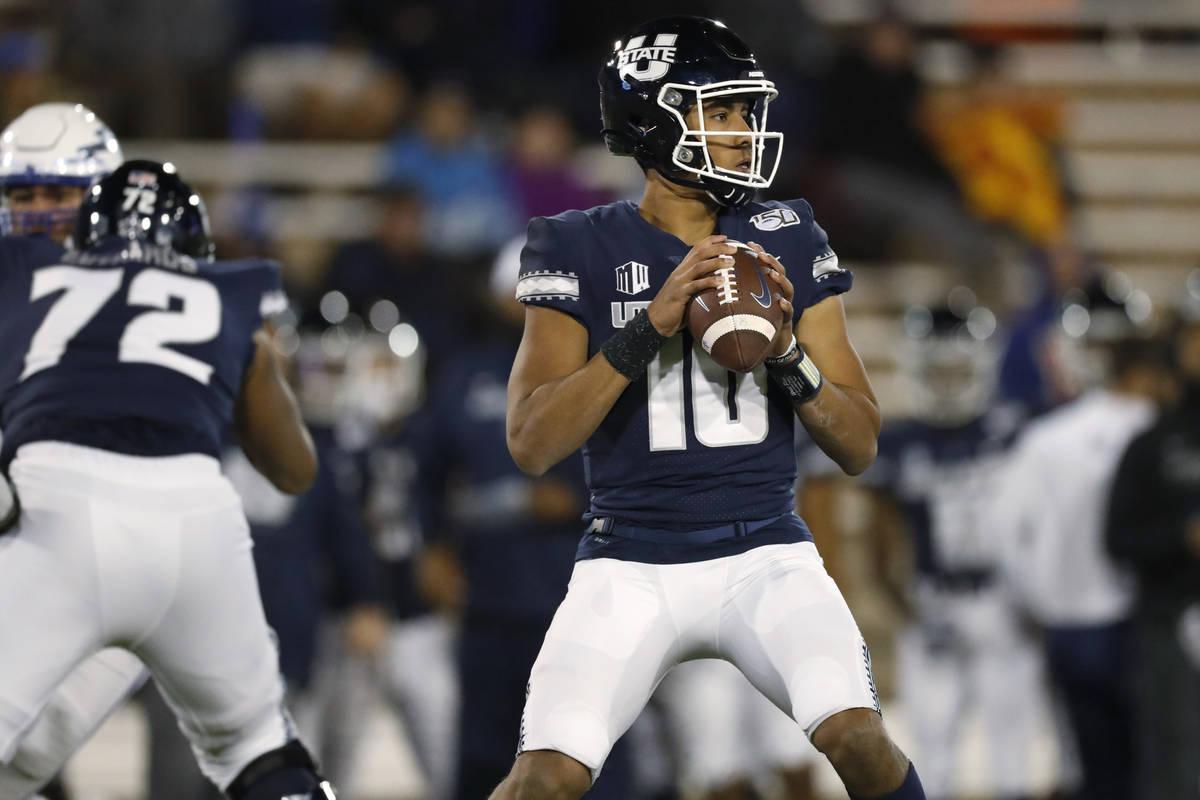 FILE - In this Oct. 26, 2019, file photo, Utah State quarterback Jordan Love looks for a receiv ...