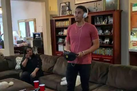 In this still image from video provided by the NFL, Jordan Love listens on his headphones durin ...