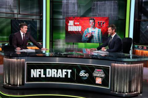 In a photo provided by ESPN Images, Rece Davis, left, and Jesse Palmer discuss the NFL football ...