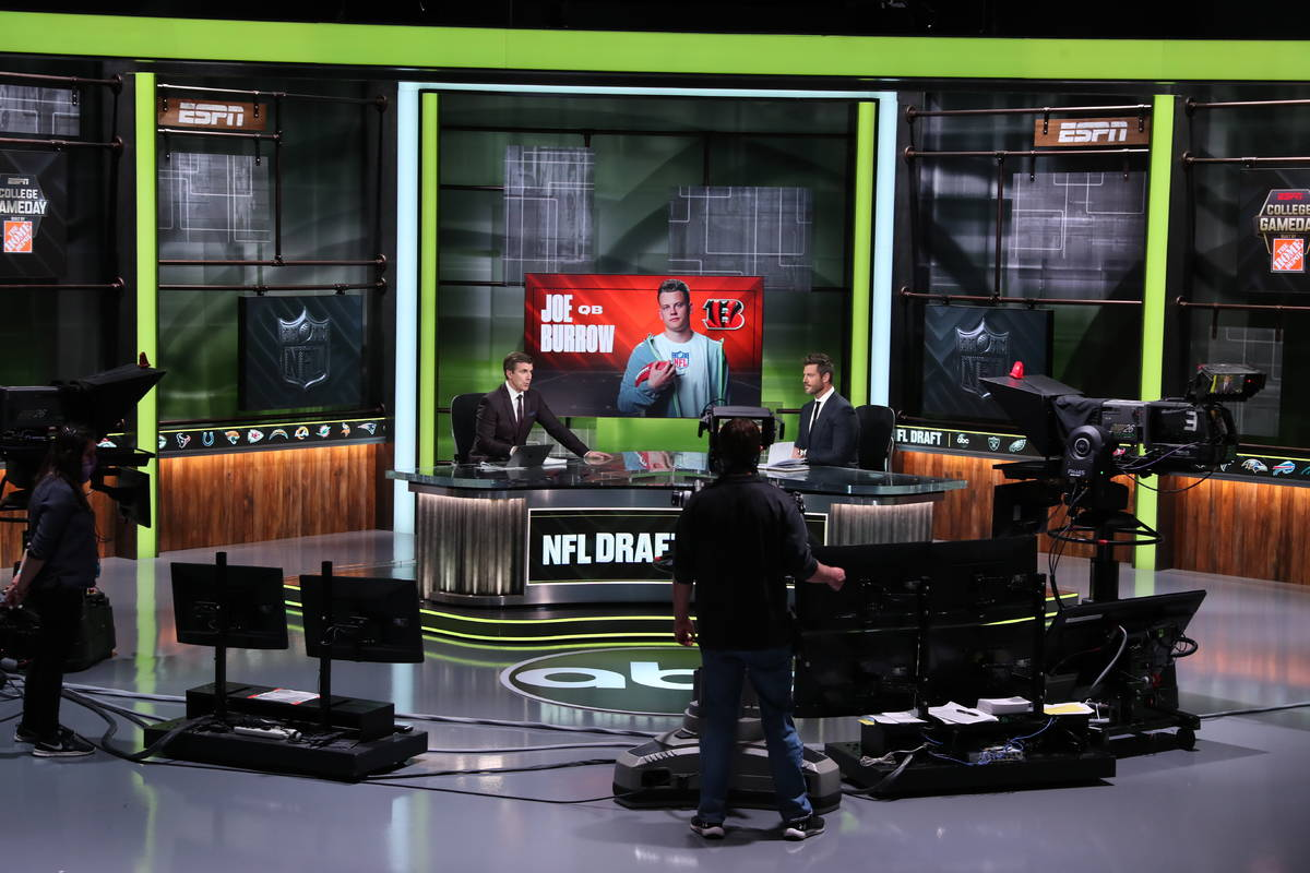 In a photo provided by ESPN Images, ESPN provides coverage of the NFL football draft, Thursday, ...