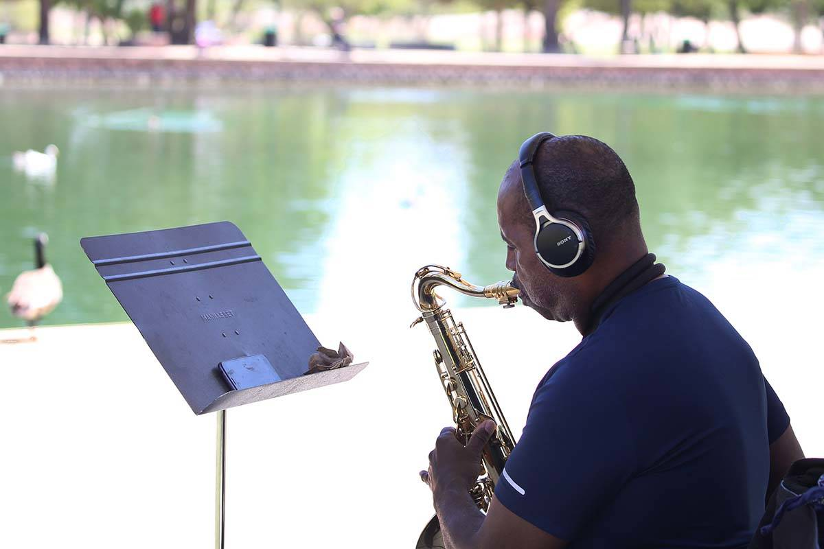 Jose Kuykendall, a local hospital nurse, plays his saxophone during a sunny day at Sunset Park. ...