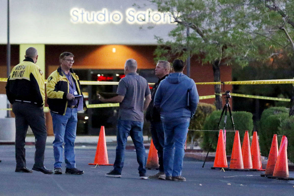 Las Vegas police investigate a homicide after a man was found dead in the parking lot of a stri ...