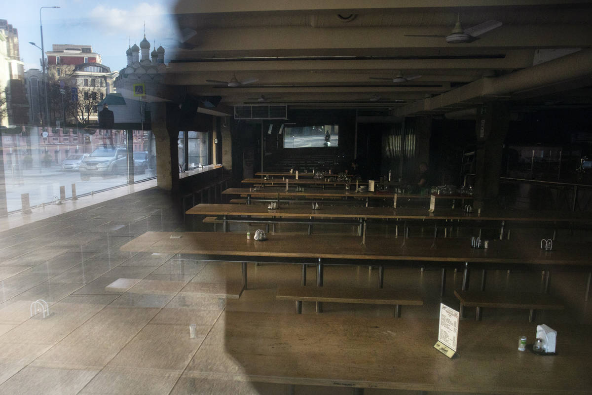 In this photo taken on Wednesday, April 22, 2020, a bar is closed in Moscow's downtown, Russia. ...