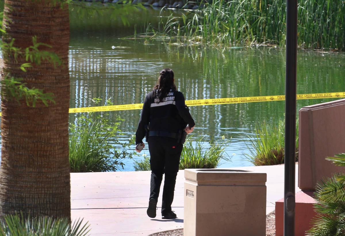 A Las Vegas police crime scene investigation officer works as Las Vegas police investigate afte ...