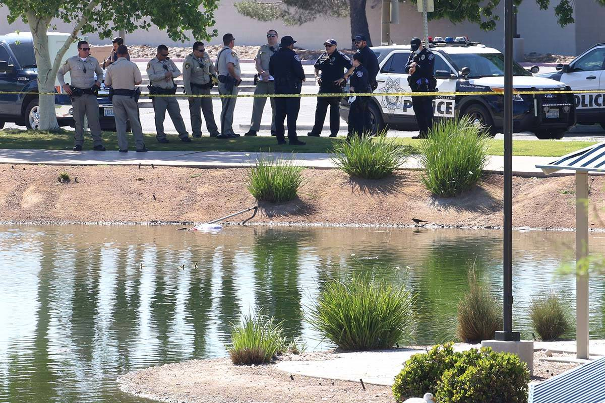 Las Vegas police investigate after a body was found in water at Lorenzi Park on Monday, April 2 ...