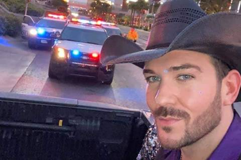 Las Vegas country artist Chase Brown takes a selfie with Metro units in the background on the S ...