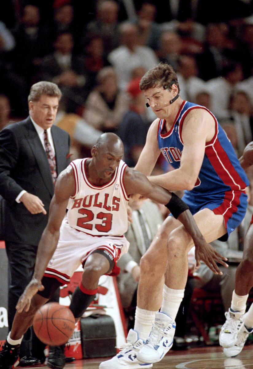 The Chicago Bulls' Michael Jordan (23) moves around the Detroit Pistons' Bill Laimbeer (40) dur ...
