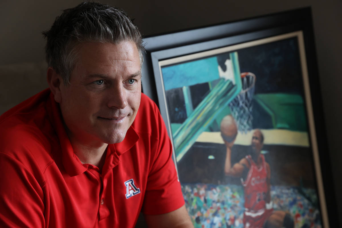 Trent Othick poses in front of a Michael Jordan painting inside his Las Vegas home, Tuesday, Ap ...