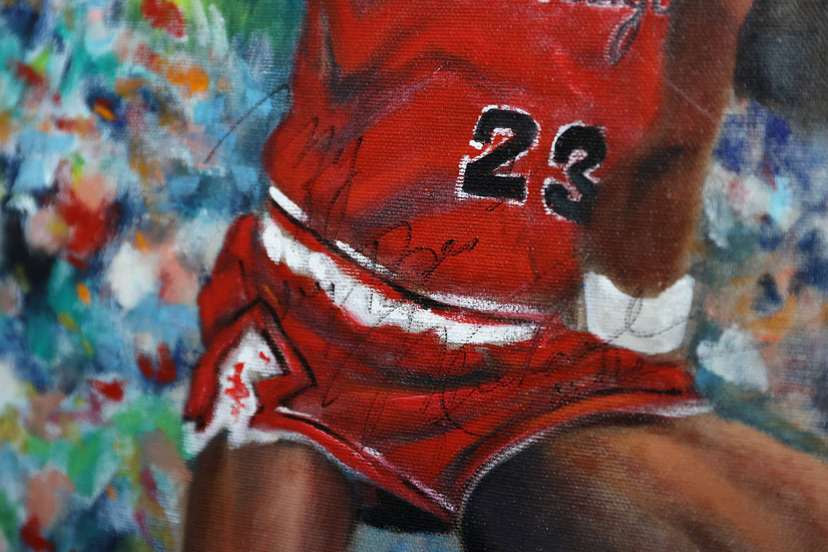 A signed Michael Jordan painting inside the home of Trent Othick in Las Vegas, Tuesday, April 2 ...