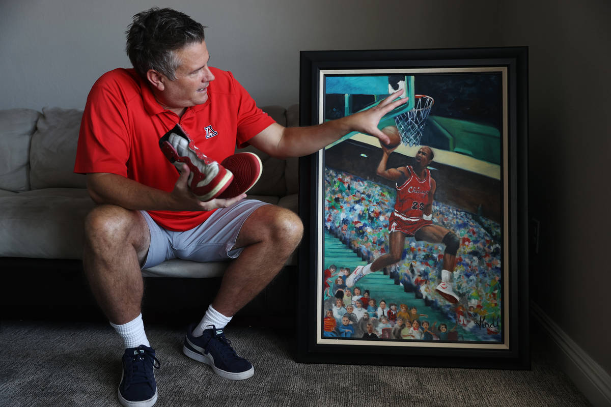 Trent Othick shows a paining of Michael Jordan painting inside his Las Vegas home, Tuesday, Apr ...