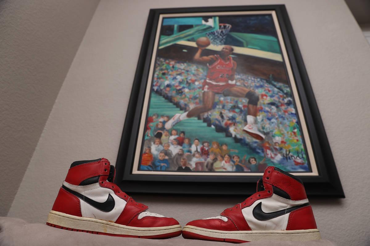 Air Jordan 1 shoes in front of a Michael Jordan waiting at the home of Trent Othick in Las Vega ...