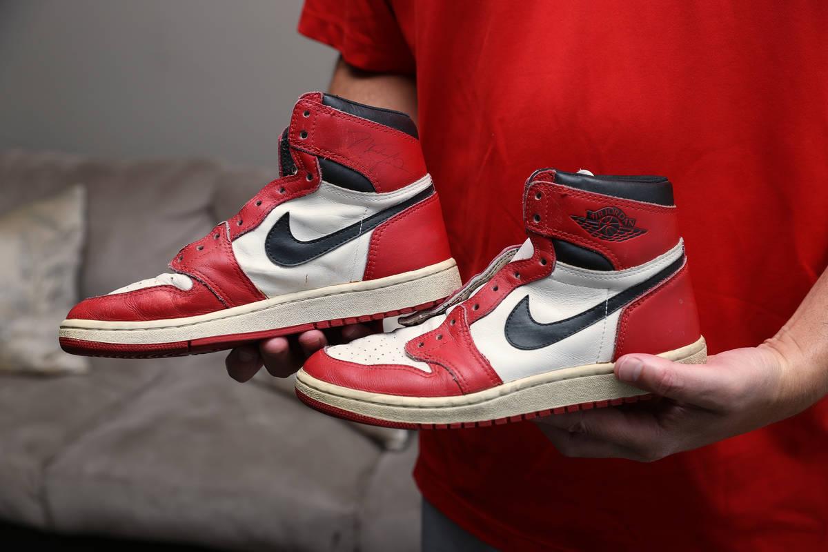 Trent Othick shows a pair of Air Jordan 1 shoes signed by Michael Jordan inside his Las Vegas h ...