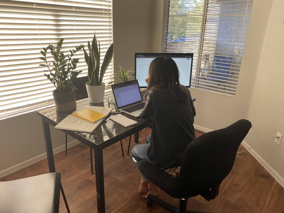 Las Vegas Review-Journal reporter Rio Lacanlale works from home Tuesday after recovering from C ...