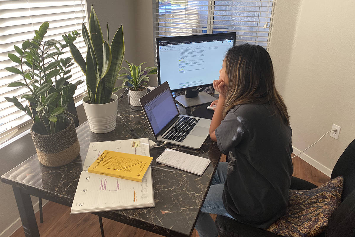 Las Vegas Review-Journal reporter Rio Lacanlale works from home Tuesday, April 28, 2020, after ...