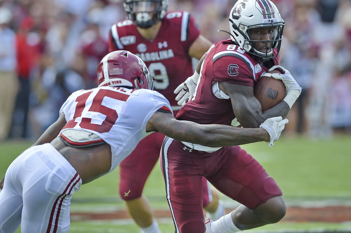 South Carolina's Bryan Edwards (89) rushes while defended by Alabama's Xavier McKinney during t ...