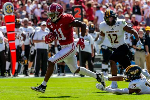 In this Sept. 21, 2019, file photo, Alabama wide receiver Henry Ruggs (11) runs in for a touchd ...