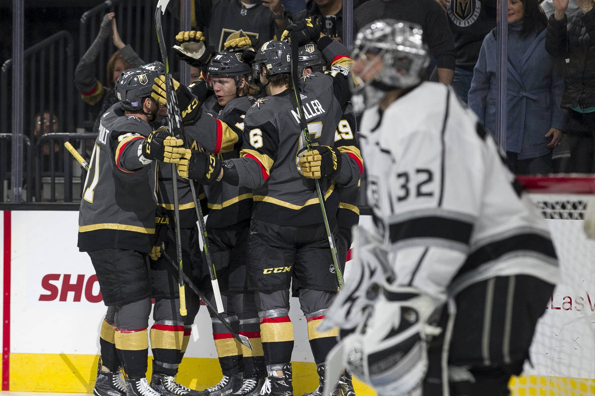 Los Angeles Kings goalie Jonathan Quick (32) looks on as the Vegas Golden Knights celebrate a g ...