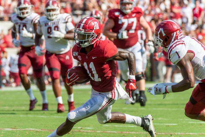 Alabama wide receiver Henry Ruggs III (11) runs free against New Mexico State during the first ...