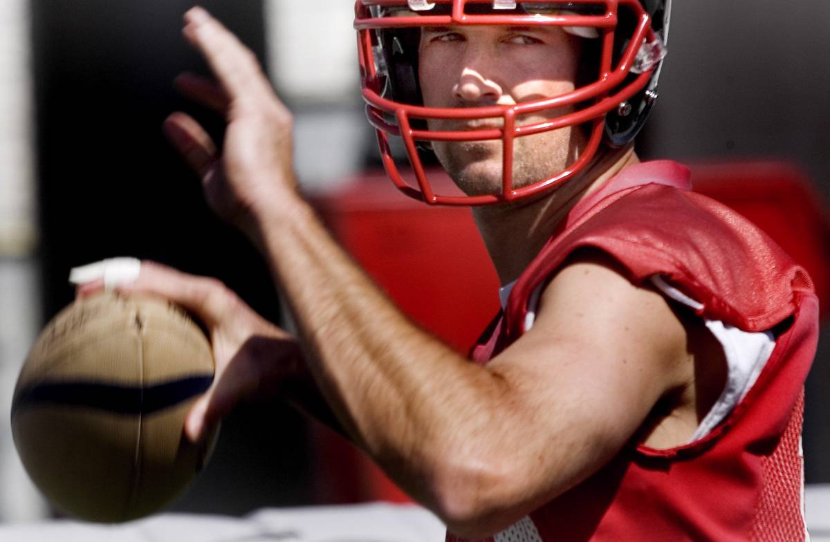 Sports; Gladiatiors quarterback, Clint Dolezel looks to throw a pass during practice at Sam Boy ...